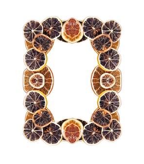 Frame of dry slices of orange and grapefruit on white fruit chips background