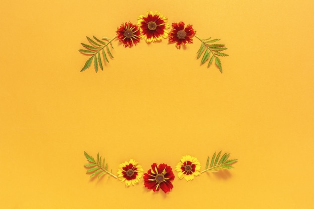 Frame floral round wreath of yellow red flowers on orange