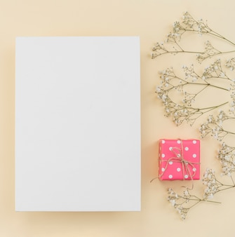 Frame flower decorated with gift box