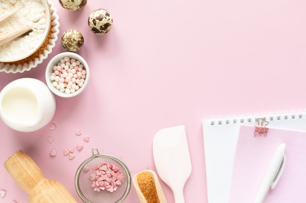 Frame of food ingredients for baking on a gently pink pastel. baking concept.