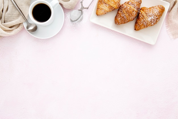 Frame of french croissants and coffee copy space