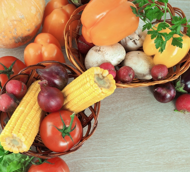 Frame of fresh vegetables on a wooden background.photo with copy space.