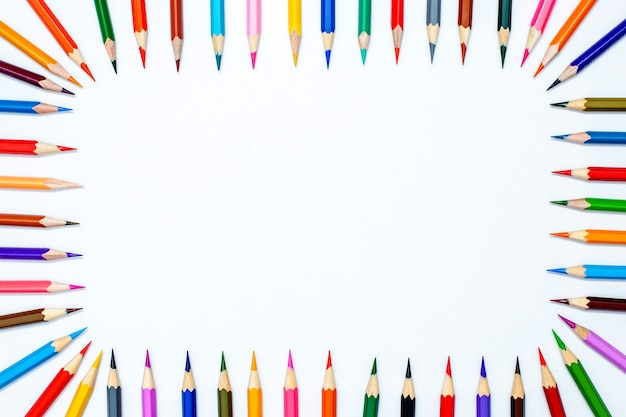 Frame from color pencils in a row with the top on a white background..copy space. top view