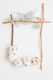 Frame from cotton twigs and flowers