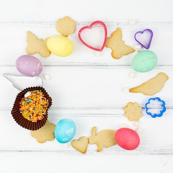 Frame from easter eggs with animal shaped cookies