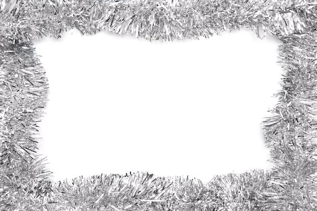 Рамка из серой мишуры на белом фоне. изолированные на белом. шаблон