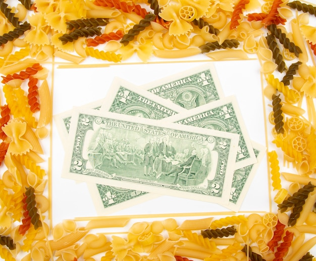 Frame from italian pasta with dollars. flour products and food in cooking