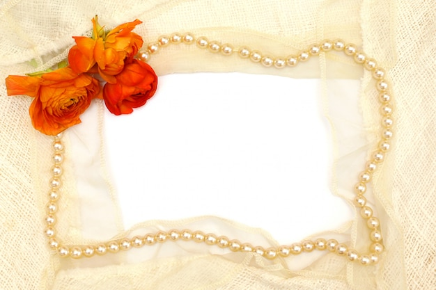 Frame from the orange flowers, pearls and white lace