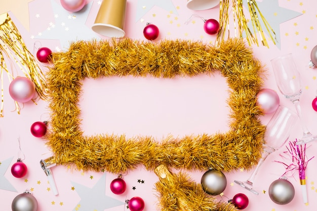 Frame from tinsel with baubles
