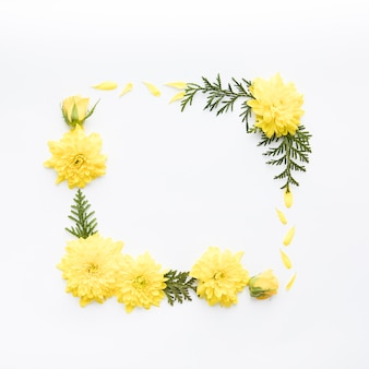 Frame from yellow flowers and leaves