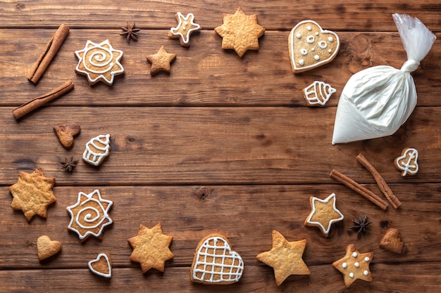 Frame of ginger cookies on a wooden background.