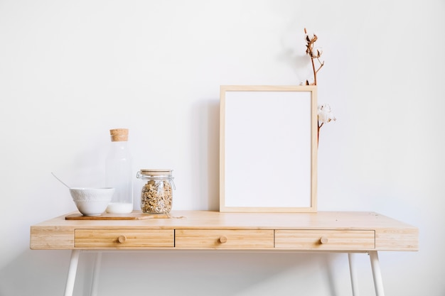 Frame and glasses on table