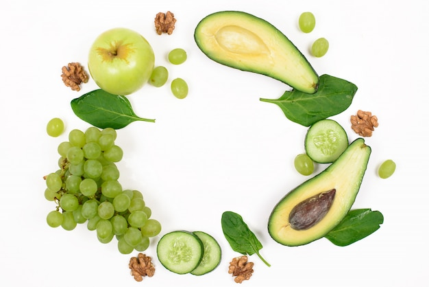Frame of green fruits and vegetables on a white isolated. concept of detox and healthy lifestyle. top view with space for text