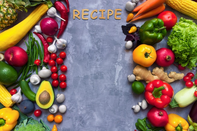 Frame of healthy colorful spicy flavoured seasoning with fresh summer organic antioxidant fruits and vegetables for vegan or vegetarian recipes isolated on grey background. healthy lifestyle concept