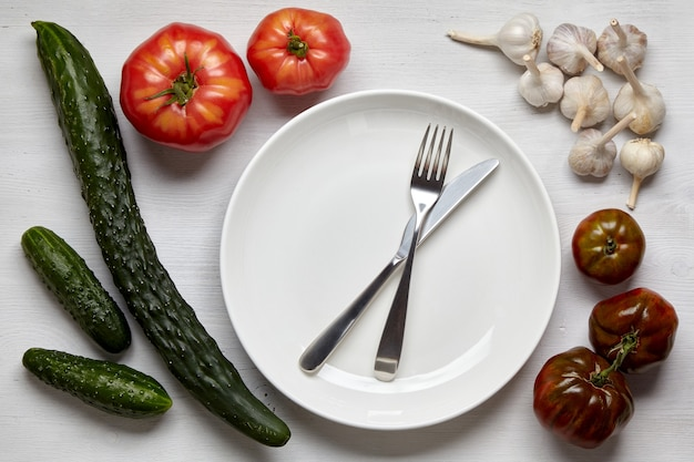 A frame of homegrown vegetables on a wooden table