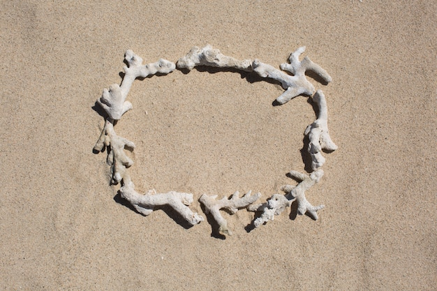 Frame of inscription of coral debris on the sand.