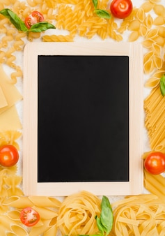 Frame of italian pasta and chalkboard