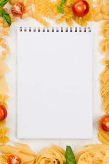 Frame of italian pasta with notebook