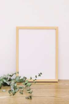 Frame leaning against wall with leaves