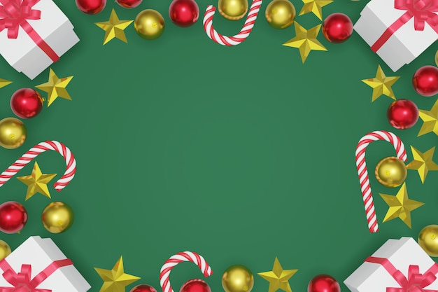 Frame made of christmas decoration on green background for greeting card. top view