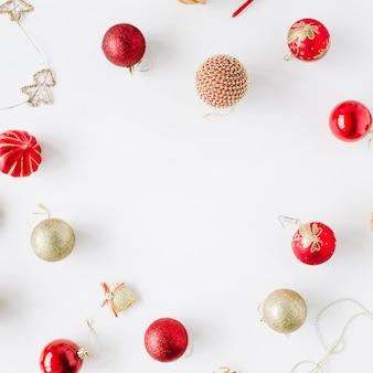 Frame made of christmas decoration with christmas glass balls, tinsel, bow. christmas wallpaper.