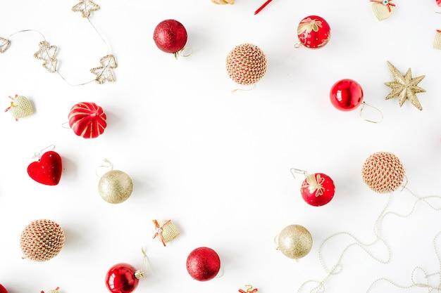 Frame made of christmas decoration with christmas glass balls, tinsel, bow.
