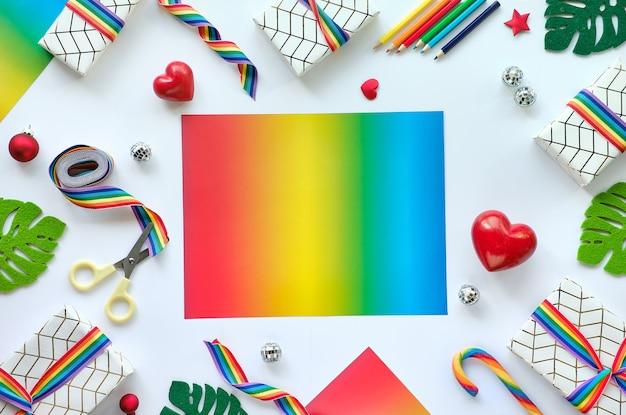 Frame made of christmas gifts with rainbow ribbon in lgbtq community flag colors