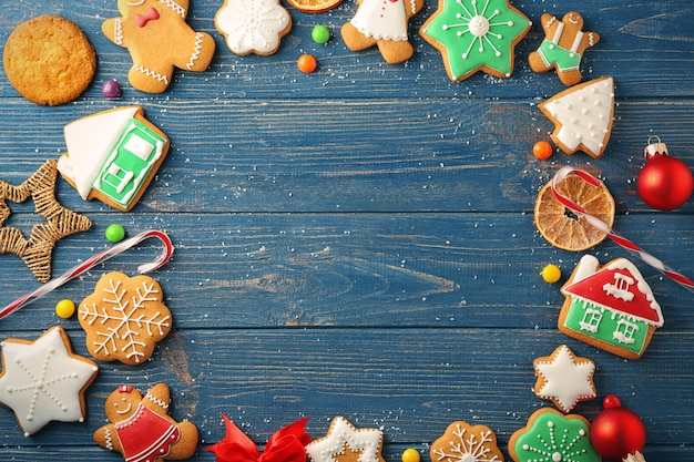 Frame made of creative christmas cookies on wooden background