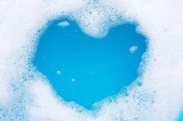 Frame made of detergent foam bubble. heart shape