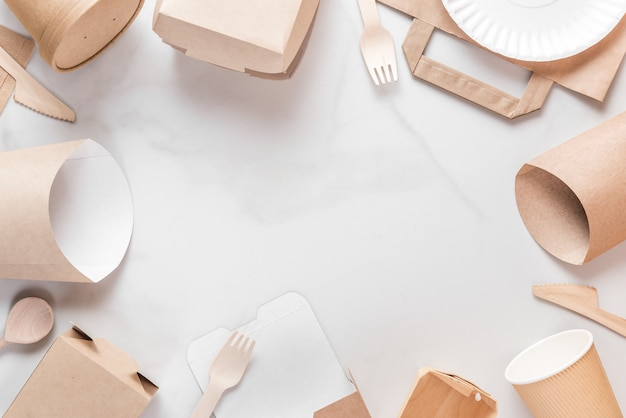 Frame made of eco friendly disposable tableware. paper cups, dishes, bag, fast food containers and bamboo wooden cutlery