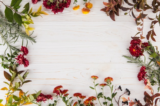 Frame made from different flowers on table