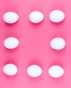 Frame made from white eggs on table
