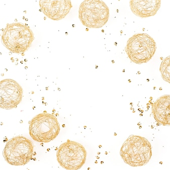 Frame made of gold decorative balls on a white background