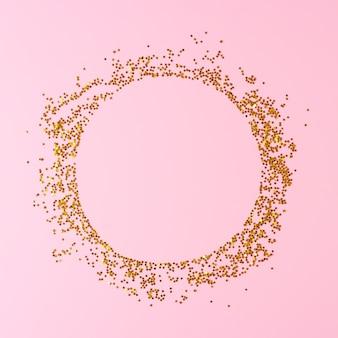 ピンクの背景に金色の紙吹雪で作られたフレーム