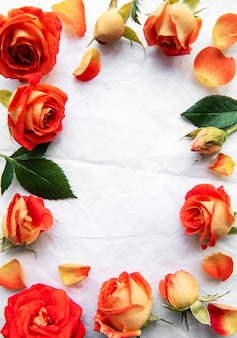Frame made of red roses and leaves