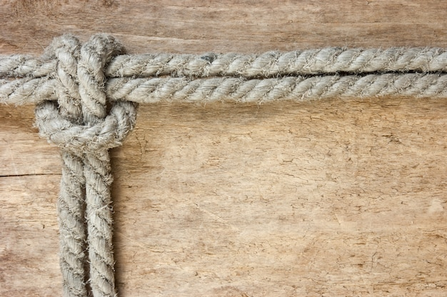 Frame made of rope on a wooden space