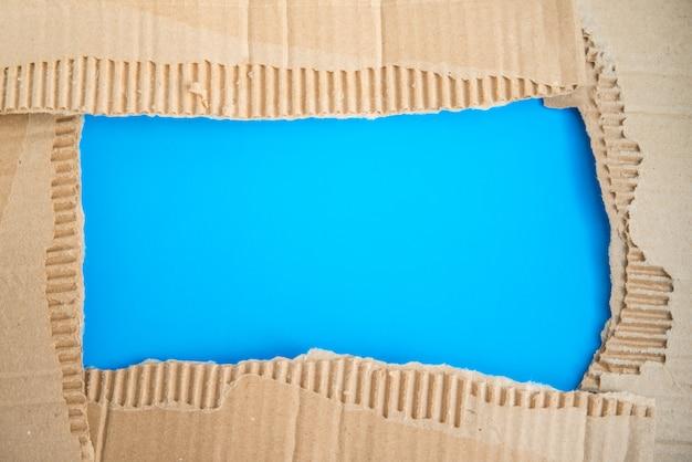 Frame made of torn corrugated brown cardboard