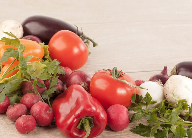 Frame made of vegetables on wooden background.photo with copy space.