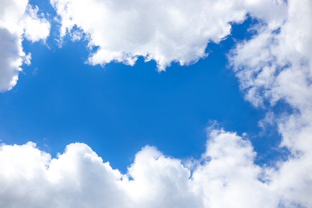 Frame made of white clouds against a bright blue sky. space for text, copy space.