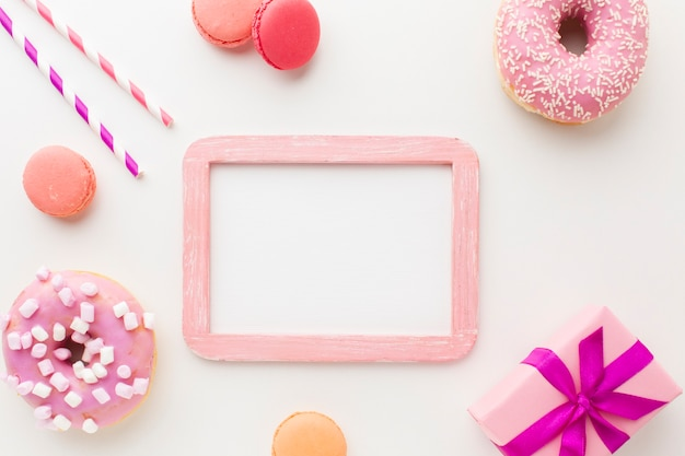 Frame mock-up surrounded by donuts