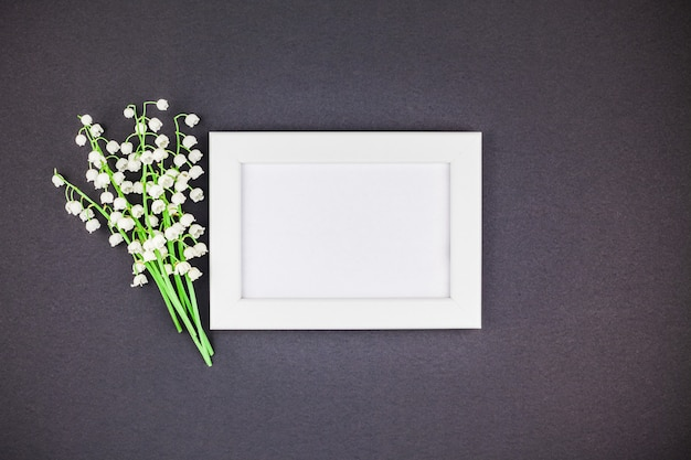 Frame mock up with bouquet of lilies of the valley