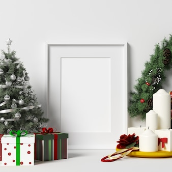 Frame mockup on white wall with christmas decoration