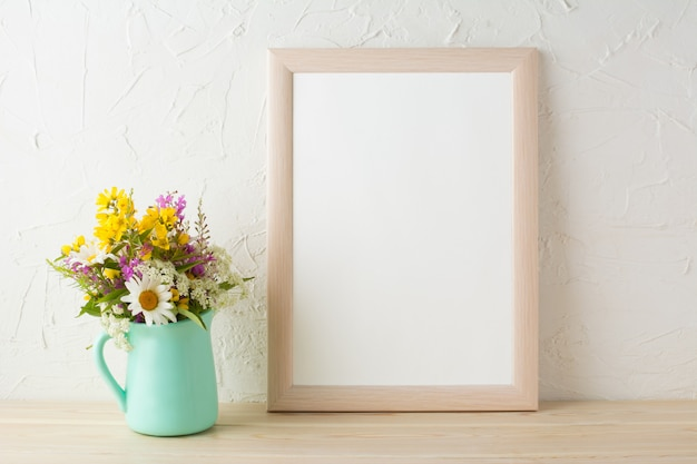 Frame mockup with flowers in mint green vase