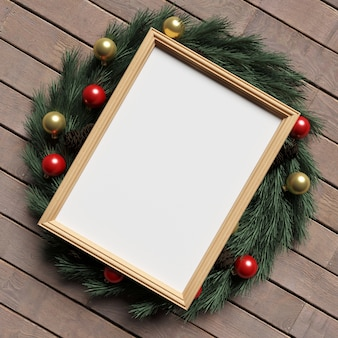 Frame mockup on wooden floor with christmas decoration