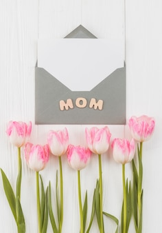 Frame for mother`s day with envelope and tulips