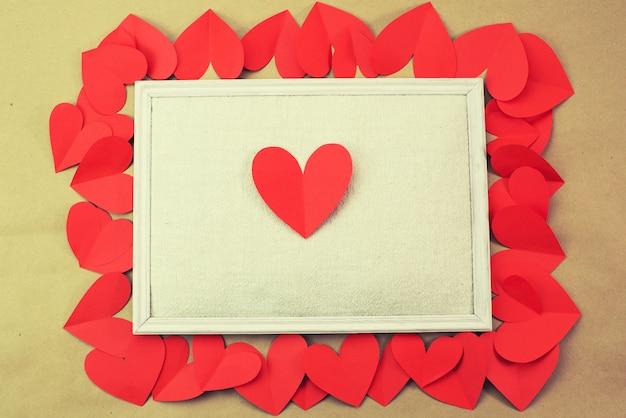 발렌타인의 텍스트 개념에 대 한 빨간 하트 배경의 프레임