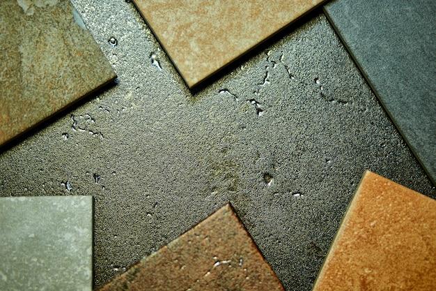 Рама различных образцов различных декоративных плиток на камне.