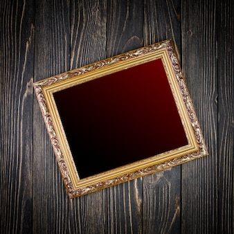 Frame on old wooden table
