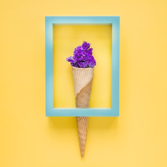 Frame on cone with flowers