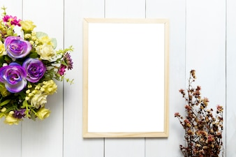 Frame over white wood table background for mockup